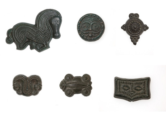 Fig. 7: Avaric matrices for pressing the jewelry, belt sets and horse harnesses from 7th century found in Biskupija; bronze; above row (from left to right): 7,2 × 5,3; 2,9 × 2,1; 1,5 × 2,2 cm, lower row (from left to right): 2,9 × 2,1; 2,9 × 2,1; 1,5 × 2,2 cm; Museum of Croatian Archaeological Monuments. Credit: Z. Alajbeg