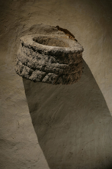 Fig. 27: Small holy water font in the southern wall of the annex of St George Church from the first half of the 13th century. Credit: Jan Gloc – Martin Frouz