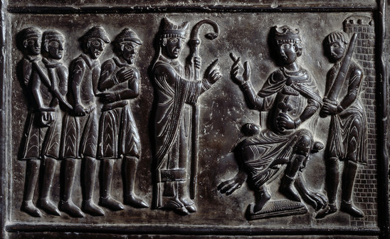 Fig. 18: Bishop Adalbert calls on Jewish merchants to buy the freedom of Christian slaves. Bronze doors of the Gniezno Cathedral, around 1175. Credit: Jaroslav Prokop