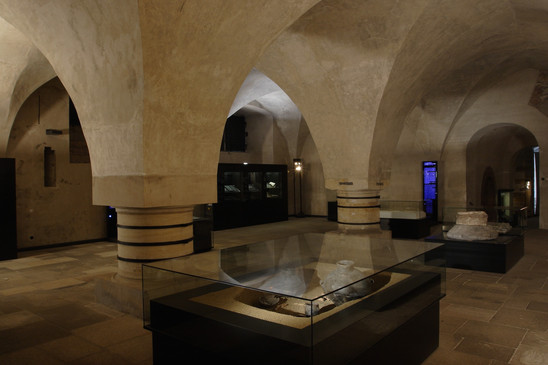 Fig. 35: Exhibition of the 'Story of Prague Castle', room of the Old Land Rolls in the basement of the Old Royal Palace. Credit: Jan Gloc