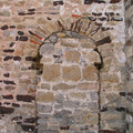 Fig. 12: Ancient doorway in the north wall of the chancel of the Ottonian Saint-Martin's church, spolia (reused building materials) of the Gallo-Roman settlement and Roman tradition of architecture with rounded arches. Credit: The Provinciaal Archeologisch Museum Velzeke